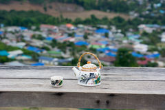 Tea pot and cup with beautiful background. Tea pot and cup with beautiful view Stock Photo