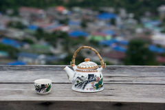 Tea pot and cup on wood table. Tea pot and cup on wood table with beautiful view Royalty Free Stock Photos