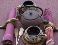 Tea pot and cups. Antique tea pot and cups Royalty Free Stock Images
