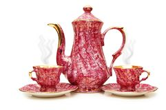 Tea pot and cups isolated. On  the white Stock Photo
