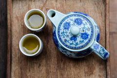 Tea pot and cups. On wooden tray Stock Photo
