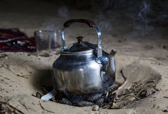 Tea pot on fire in a desert Stock Image