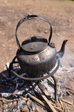 Tea pot on firewood Royalty Free Stock Photo