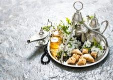 Tea pot and glasses, sweets. Islamic holidays. Hari Raya Aidilfi. Tea pot and glasses, sweets, traditional oriental delight baklava. Hari Raya Aidilfitri Royalty Free Stock Image