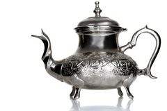 Tea pot. Image of a Moroccan tea pot in a studio table Royalty Free Stock Photos