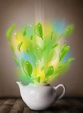 Tea pot with leaves and colorful abstract lights Royalty Free Stock Photos