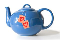 Tea pot and loving teabags Royalty Free Stock Image