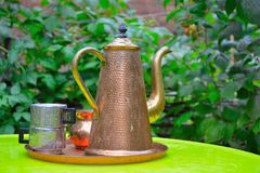 Tea-pot and metal cups Royalty Free Stock Photography
