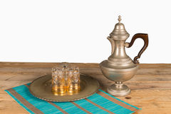 Tea pot and Moroccan glasses. Old brass tea pot and Moroccan glasses Royalty Free Stock Photo