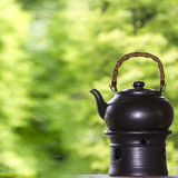 Tea pot with nice background Royalty Free Stock Photo