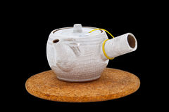 Tea pot with place mat on isolation Stock Images