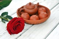 Tea pot and rose Stock Image