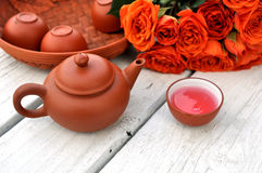Tea pot and rose Stock Photo