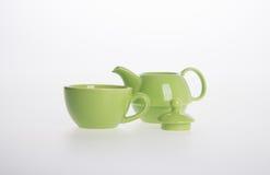 Tea pot set or Porcelain tea pot and cup on background. Stock Photos