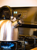 Tea Pot on Stove Stock Images