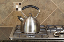 Tea Pot on Stove Top Stock Photo