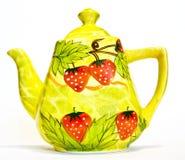 Tea pot with strawberry Stock Photos
