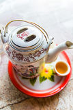 Tea pot with tea in asia. Stock Photo