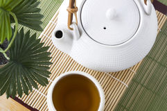 Tea pot with tea cup Stock Image