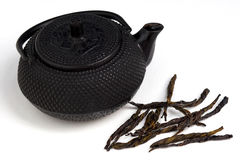 Tea pot and tea leaves Royalty Free Stock Photo