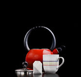 Tea pot, teabag and a cup Royalty Free Stock Photography