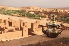 Tea Pot. A traditional silver tea pot set on a wall overlooking the Ksar of Ait Ben Haddou, Morocco Stock Photos