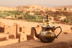 Tea Pot. A traditional silver tea pot sitting on a wall overlooking the Ksar of Ait Ben Haddou, Morocco Royalty Free Stock Photography