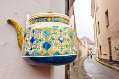 Tea pot on a wall in the old town of Vilnius Stock Photos