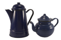 Tea pots. Two dark blue tea pots with isolated white background stock images