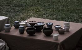 Tea ceramics at an outdoor market. Tea pots, gaiwans and cups on sale at an outdoor market in summer Royalty Free Stock Photography