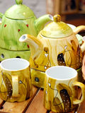 Tea pots and mugs Stock Photography