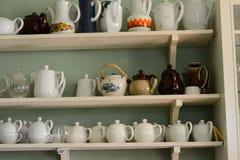 Tea pots on shelves Stock Images