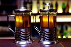 tea in tea pots stock images