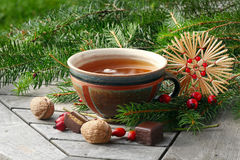 Tea in a pottery cup with Christmas decoration and goodies, Stock Photography