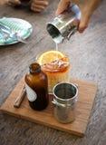 Tea or pour some tea into the glass. Lemon tea or pour some tea into the glass Royalty Free Stock Images