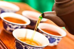 Tea is poured into the cup Royalty Free Stock Images