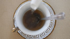 Tea is poured into cup. Pour boiling water tea from a teapot. Slow motion Close up stock video footage
