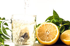 Tea is poured into glass. With lemon Royalty Free Stock Photography