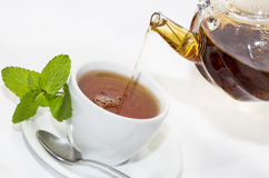 Tea poured from a teapot Royalty Free Stock Image