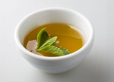 Tea poured in a white bowl Stock Photography