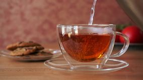 Tea Pouring into Cup Slow Motion stock video footage
