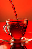 Tea pouring into glass cup Stock Image