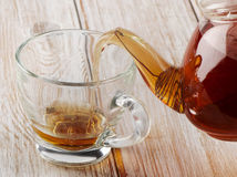 Tea pouring into a glass cup Royalty Free Stock Photo