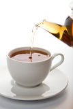 Tea Pouring Into White Cup Isolated Stock Photos