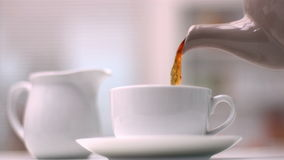 Tea pouring from pot stock video footage