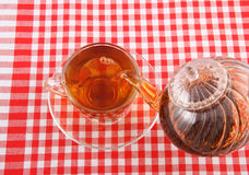 Tea pouring on tablecloth Royalty Free Stock Photo