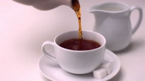 Tea pouring into tea cup Royalty Free Stock Photo