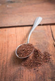 Tea powder on spoon. Stock Images