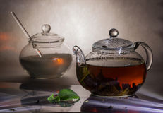 Tea preparation in a glass teapot. On a grey background Royalty Free Stock Image