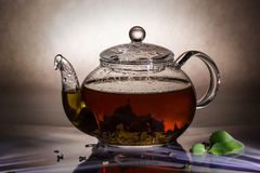 Tea preparation in a glass teapot. On a grey background Stock Photo